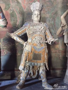 A guardian of a celestial domain, the 12th century Chinese colour statue in Shanhua Temple, Datong, Shanxi Province