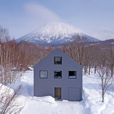 on the japanese island of hokkaido, florian busch architects has completed 'K house' a two-storey residence with views of a nearby volcanic mountain.