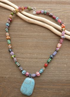 Turquoise and silver stone pendant with clay beads necklace. Andria Bieber Designs