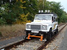 Land Rover using a road-rail adapter to drive on railroad tracks. With so many old, closed rail lines think of the interesting travel possibilities! With much less weight involved with a vehicle,(or a camper, or a motorhome!) it *seems* like rail maintenance, bed reinforcement, etc., would be less expensive than it would be for a rail line with heavy locomotives and rail cars. More info on road-rail vehicles: https://en.wikipedia.org/wiki/Road-rail_vehicle