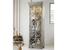 Concentric circles bring a relaxing harmony to the Celeste Display Cabinet.