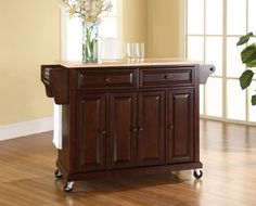 Crosley Furniture Natural Wood Top Kitchen Cart/Island, Vintage Mahogany Crosley Furniture http://www.amazon.com/dp/B004X4VZ8K/ref=cm_sw_r_pi_dp_mEhgvb0B3Z0DW