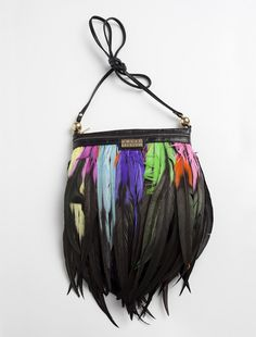 DIY Feather decorated second hand leather bag.