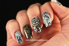 black white and gold nails with animal print