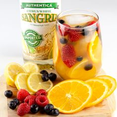 Say hello to warmer weather with this Authentica Sangria spring cocktail!  What you'll need: -1/2 lemon, thinly sliced -1 orange, thinly sliced -1 cup raspberries -1 cup blueberries -1 bottle Authentica Citrus White Sangria -1 bottle sparkling wine -1 cup orange juice  Directions: Put fruit, orange juice & Sangria in  large pitcher. Refrigerate for 3 hours or up to 1 day. Before serving, stir and add the sparkling wine! #sangria #sangriarecipe #cocktails #drinkrecipes #springcocktail Sangria Cocktail, White Sangria, Spring Cocktails, Raspberries, Blueberries, Sangria Recipes, Sparkling Wine, Fine Wine, Orange Juice