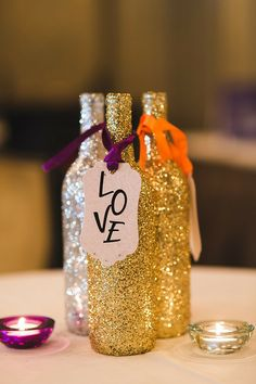 Have old Sutter Home bottles lying around? Cover them with glitter for party decorations!