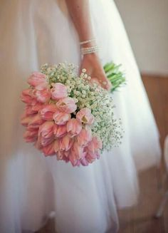Pink tulips and baby's breath wedding bouquet. Very sweet.