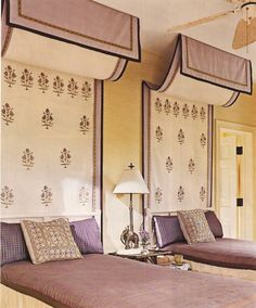 guest room of twin bed with canopies of Italian Renaissance like tapestries and Moorish inspired accent pillows and lamp
