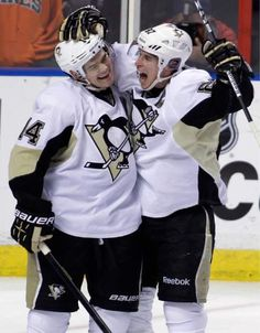 The Penguins' Chris Kunitz celebrates with Sidney Crosby after Kunitz scored against the Panthers during the second period Tuesday, Feb. 26, 2013, in Sunrise, Fla.