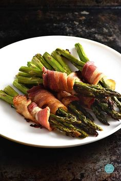 Bacon Wrapped Asparagus Recipe - Beautiful side dish for entertaining or suppers with family! from addapinch.com