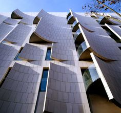 Originally Hotel Omm. The distinctive exterior is an ode to function-driven design. Sections of the unusual limestone façade teasingly peel back like pages of a book, allowing the sunlight to stream into the hotel's 91 rooms and suites while ensuring that guests are ensconced in complete privacy.
