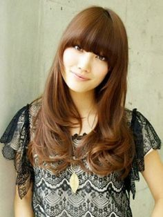 Long sleek hairstyle with curly locks and bangs