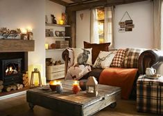 Simple ways to adjust your fall home decor whether you have a rustic, elegant or. Simple ways to adjust your fall home decor whether you have a rustic, elegant or minimalist home. Here& 5 easy ways to add cozy to your fall home decor. Cottage Living Rooms, Home Living Room, Living Room Designs, Woodland Living Room, Cosy Living Room Warm, Cosy Living Room Decor, Warm Colours Living Room, Country Living Room Rustic, Living Area
