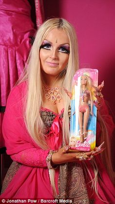 Lhouraii Li, from England, spends four hours every day to do this to herself! She wears 14 pairs of false eyelashes, glued together, to get this 'Barbie doll' look. Mattel should sue her - Barbie would be horrified, I'm sure.