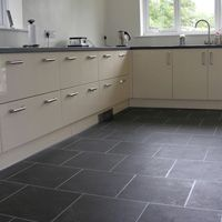 Vinyl units in cream, replace handles, grey Lino in the kitchen.