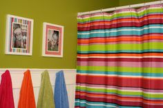 One Shy of the Brady Bunch: Kids' Bathroom Redo I like the towel hooks and that the towels are all different colors, each kid could have their own color of towels to keep track of!