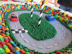 Race car cake at a Cars Party #cars #partycake,