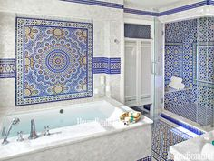 80  Beautiful Designer Bathrooms. In a Cape Cod, Massachusetts, bathroom designed by Kyle Timothy Blood, the mesmerizing patterns of Moroccan tile, from Mosaic House, evoke the atmosphere of a traditional hammam. Kohler's Underscore Bubble Massage tub is rimmed with Princess White quartzite.