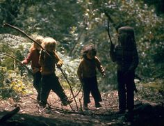 John Olson, Four children from a hippie commune walking through the woods with their sticks, Sunny Valley, Oregon, USA, 1969.