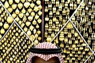 A Saudi vendor waits for customers at a gold shop in a market near the Grand Mosque in the city of Mecca, Saudi Arabia.  (Photo by Hassan Ammar / AP). First published in the October 24, 2012, 7:56 a.m. edition (http://dailysource.org/pictures/show/42026).