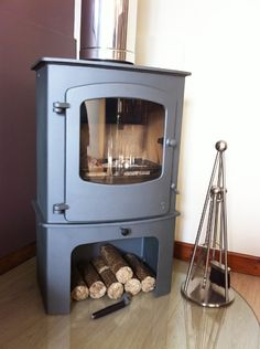 Charnwood cove 2 on log store in gun metal colour sat on clear glass hearth conn., - Charnwood cove 2 on log store in gun metal colour sat on clear glass hearth conn…, - Modern Wood Burning Stoves, Wood Burning Logs, Wood Stoves, Fireplace Gallery, Log Store, Freestanding Fireplace, Log Burner, Light My Fire, Room Pictures
