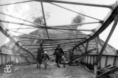 2 scouts with bicycles on the devastated bridge at #Wieprz river, Poland during the September Campaign, September #1939; #WW2 #WorldWar2 #war  #SeptemberCampaign #Poland #Polish #1930 #scouts #scouting #bridge #vintage #photography