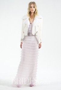 "For Autumn Brides Who Love A ""Think Outside The Box"" Look But Still Want Warmth On A Cool Fall Wedding Day  A Houghton's lambskin motorcycle jacket over layers of laser-cut petal pink silk organza with a camisole top and long sheath skirt - Perfect non-traditional choice for contemporary brides  See More Stylish Bridal Outerwear http://www.sevenivorybrides.com/autumn-brides-cover-up-in-cool-wedding-outerwear/ #SevenIvoryBrides #AutumnWeddings Photo: Delica Bridal  Original Source: Brides.com"