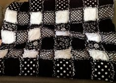 Here is a custom made black and white adult size rag quilt with a very symmetrical pattern on the front. This quilt can be made with 6 different
