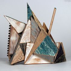 """'Scrap Mountain' (2011) from the """"Mountains and Mountains"""" series by Canadian artist & sculptor Aaron Moran (b.1986). Reclaimed wood, acrylic, house paint, pencil, 11 x 11 x 5 in. via the artist's site"""