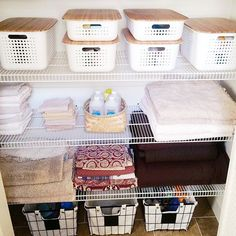 Linen closet refresh. White Nordic baskets with bamboo lids contain all hygiene items within the space. Linen lined metal baskets house cleaners, toilet paper, and overstock items. #home #inspo #bathroom #closet #organization #atlanta