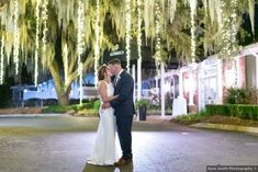 Wedding photography under willow tree with hanging lights, romantic photography lighting