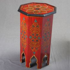http://www.artesania-marroqui.com/muebles/mesas/mesa-alta-octogonal-color-rojo-envejecido.html