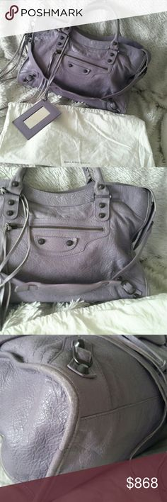 Balenciaga City Bag ON SALE TODAY! Gorgeous lavender satchel, hobo, shoulder bag in preload condition. Leather has a natural distressed characteristic and is intentionally a cracked look. The leather is soft and slouchy, and in good condition other than normal wear at corners (loss of some color). No tears. The outside features a zip pocket with leather fringe at the zipper. The top zips also have leather fringe and comes with a mirror. Inside is pristine with 1 zip pocket and logo plate…
