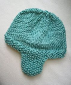 This hat is essentially the same as the previous hat, but without the ears and the addition of seed stitch flaps and edge to prevent curling...