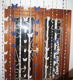 Cortina con mariposas y flores de goma eva. Ideas que decoran un zaguán.