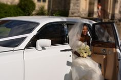 Bride coming out of a White Rolls Royce Phantom