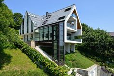 GG House is located in Krakow, Poland on a steep, south slope. It was designed by Architeckt Tadeusz Lemanski to rise up from the slope on four columns that...
