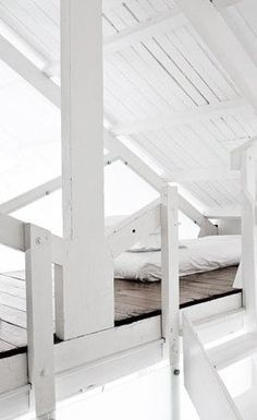 Chic modern loft which I would love to string white twinkle lights and lateens and put comfy beanbags, pillows, games, TV, etc for hanging out w friends Mini Loft, Interior Architecture, Interior And Exterior, Interior Design, Attic Spaces, Small Spaces, White Home Decor, Cozy Place, Love Home