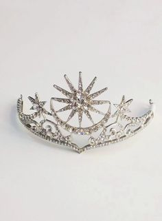 """A dazzling Eclipse Crown that is fit for a Queen. A beautifully designed piece featuring sun and moon shapes embellished with diamante. """"Pair with a glamours outfit or wear as head gear."""" One Size. Made From Synthetic Materials. South African Shop, Moon Shapes, Queen, Headgear, Sale Items, Shops, Glamour, Crown, Pairs"""