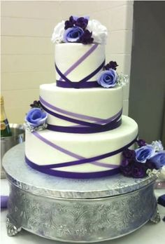 white buttercream with purple accents wedding cake  www.kittiskakes.com