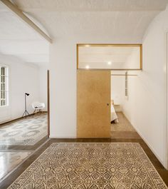 Patterned floor tiles mark out the original layout of this apartment in Barcelona, restored by local architecture student Adrian Elizalde. Interior Architecture, Interior And Exterior, Interior Design, Contemporary Architecture, Barcelona Apartment, Apartment Renovation, Small Spaces, Minimalism, Living Spaces
