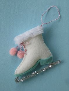 Look at this adorable little ice skate ornament!  Follow the link for the DIY plus a whole garland of cute Christmas ornaments.