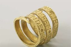 """Ring of gold, in the form of a flat spiral. Connects an inscription in Roman letters. Netherlands, ca. 1540"""