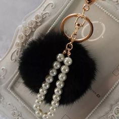 Pearl Key Charm Pearl Keychain Charm with gold head ((BUNDLE ONLY)) (Rabbit Fur Charm NOT included) Any Questions Please Ask before Purchase No Paypal || No Trades || Posh Rules Only  Shipping:  Bundle and Save on Shipping Items are shipped within 24-48 hours of payment {Mon-Fri.}  Please Check Out my other listings for the best in brand new and gently used clothing, shoes and accessories. Happy Poshing!!! Lavish Couture Accessories Key & Card Holders