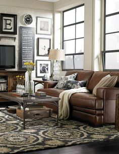 Finally a living room that my kids can live in! I love the white couch look but it just doesn't make since with kids:
