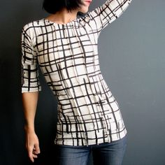This unique top is handmade completely from scratch using fabric I hand printed with my original artwork. Like all of my garments this top is My original design and one of a kind.  I screen printed off-white colored cotton/lycra knit fabric using my original sparse stripes design and black ink to make this wonderful artistic plaid-like pattern.   I gave this top a simple and very nice shape with a rounded neckline, straight sleeves that fall just above the elbow, a tapered waist and faring…
