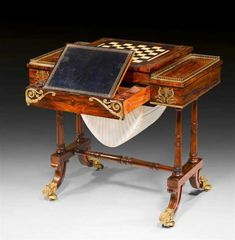 """GAMES TABLE """"AUX PATTES DE LIONS"""", Regency, England circa 1825/45."""