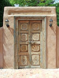 Santa Fe Doors 5 Adobe wall with carved wood garden door. Old Doors, Windows And Doors, Door Design, Exterior Design, New Mexico Style, Mud House, Santa Fe Style, Adobe House, Garden Doors