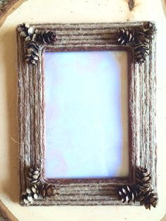 Twine and pine cone frame by BurlapbuttonsNmore on Etsy