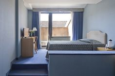 Superior Single Room with an extremely comfortable double bed, a workspace and fabulous outside terrace.